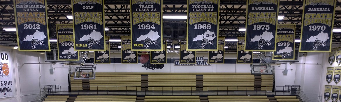 STATE CHAMPIONSHIP BANNERS hang from the Rafters at EHS.