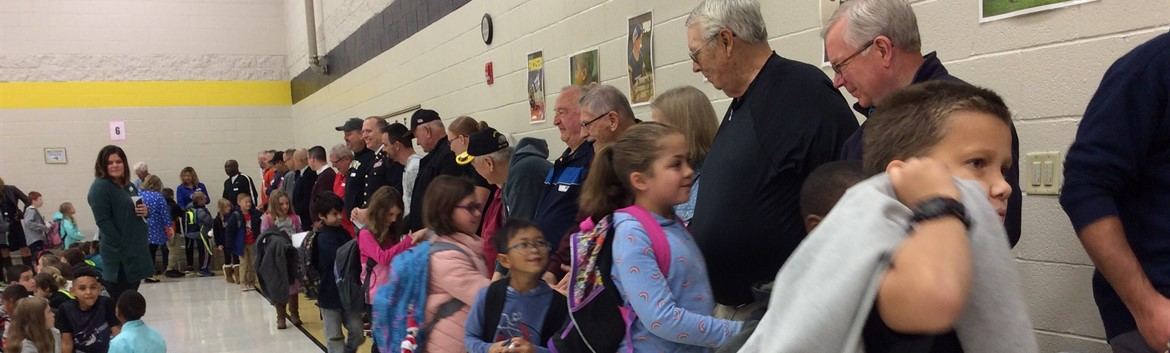 Students shaking Veteran's hands on Veterans Day