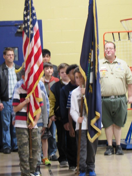 Students presenting colors with Boy Scouts.